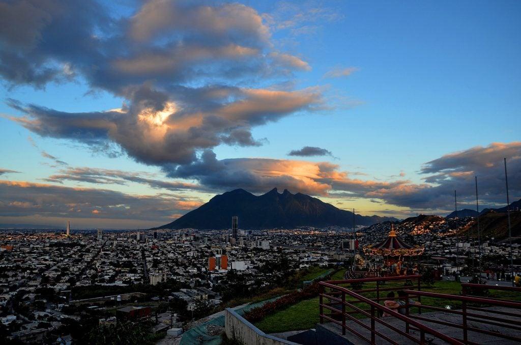 A photo of the sun setting behind Cerro de la Silla mountain in Monterrey, Mexico.