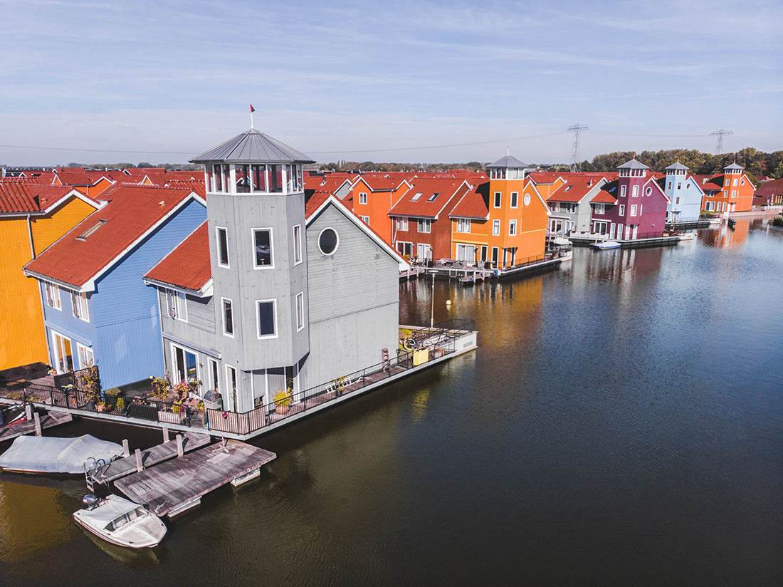 Colorful houses on the water in Groningen, Netherlands.