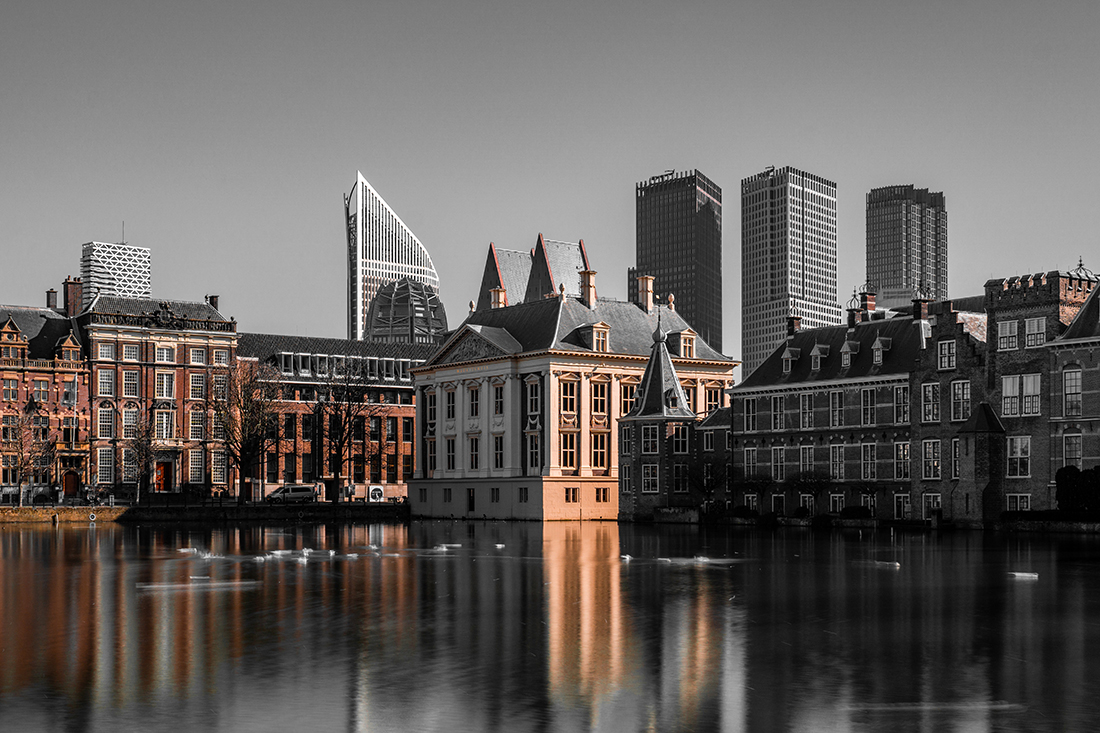 The cityscape of The Hague at twilight.