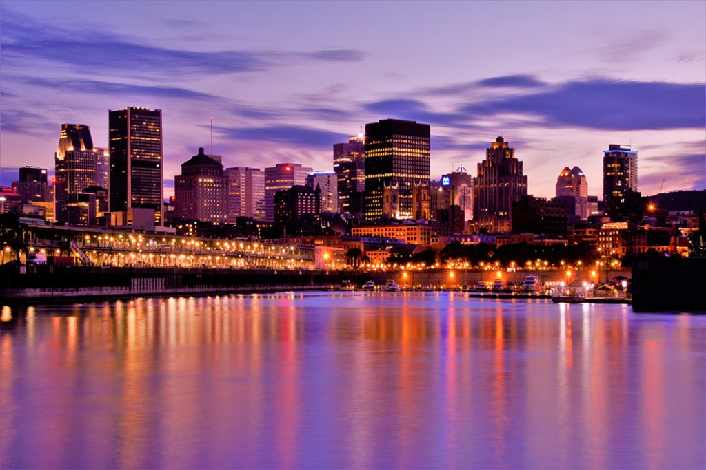 Photo of the Montreal skyline at sunset.