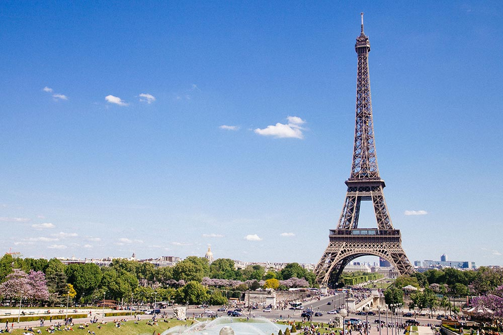 Photo of the Eiffel Tower on a sunny day in Paris.
