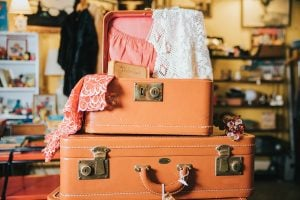 Photo of a stack of suitcases being packed for a trip.