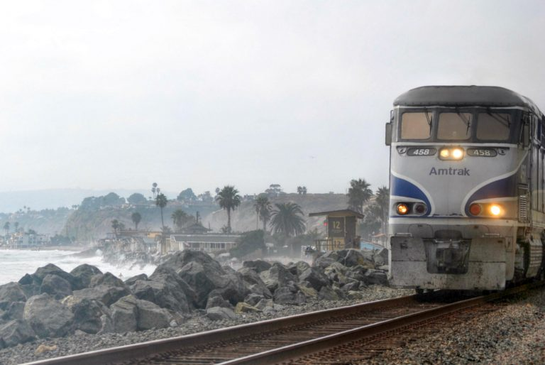 Photo of Amtrak's Pacific Surfliner traveling along the Pacific Coast.