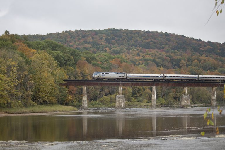 Amtrak's Vermonter crosses the White River in autumn.