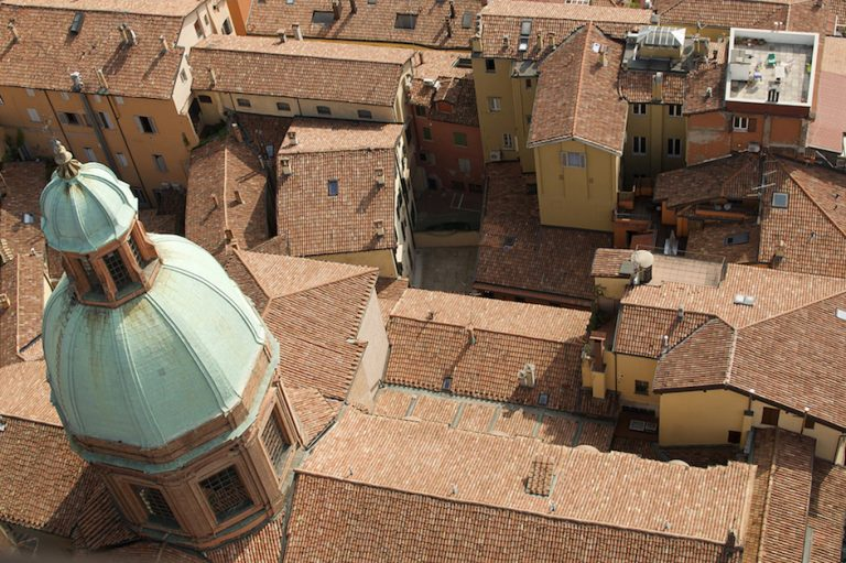 Overhead view of terra cotta roofs in Bologna.
