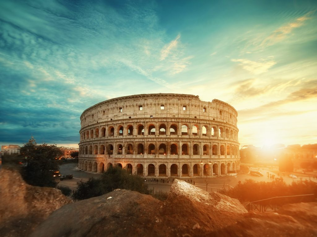 Cinematic photo of The Colosseum in Rome at sunrise.