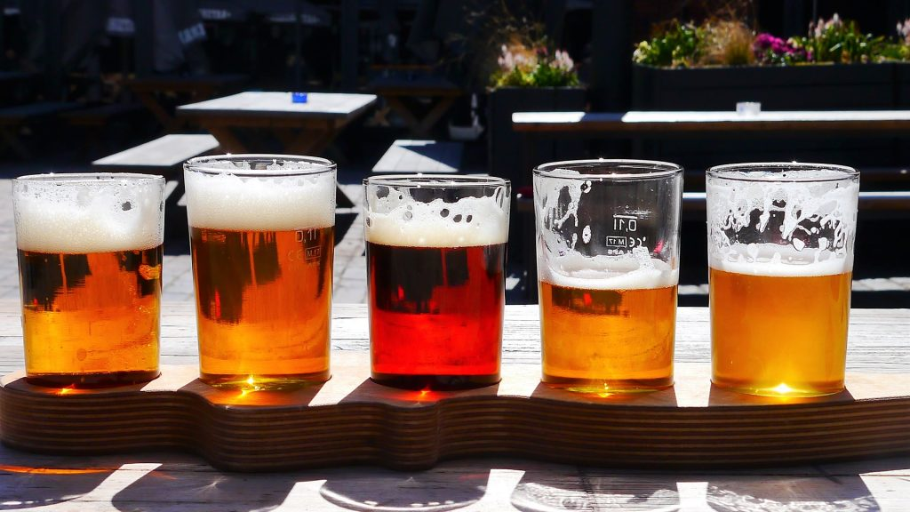 A flight of craft beer on a sunny day.