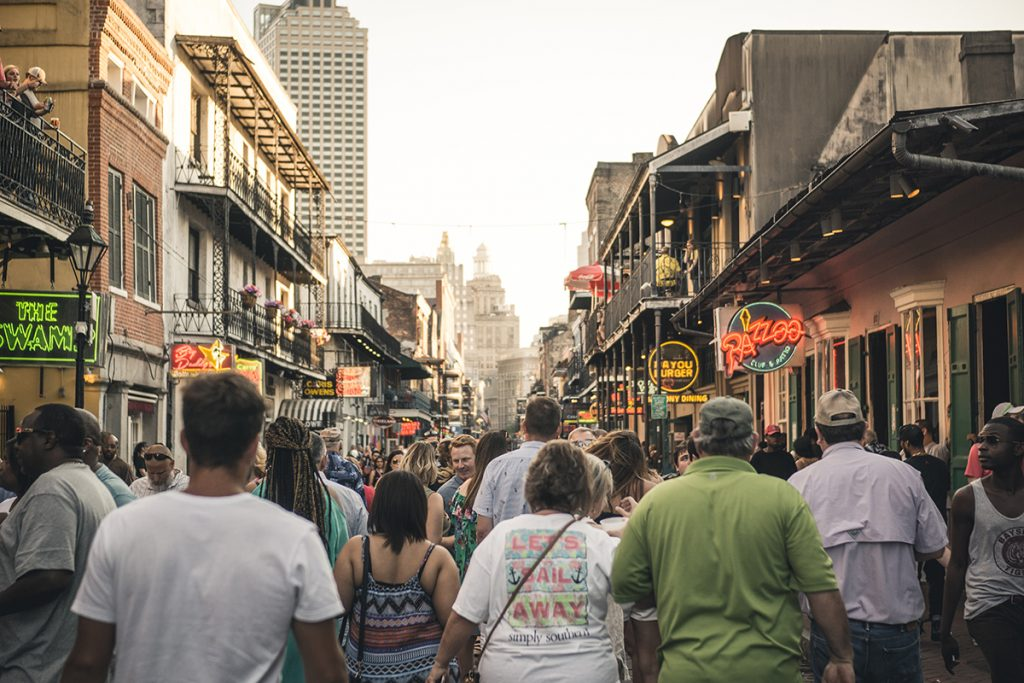 Photo of a busy Bourbon Street in New Orleans, LA.