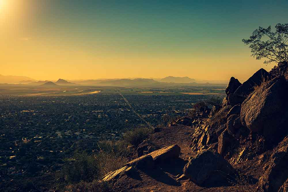 View of the sun rising atop Camelback Mountain in Phoenix.