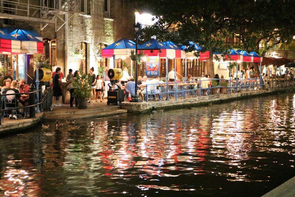 Photo of the San Antonio Riverwalk at night.