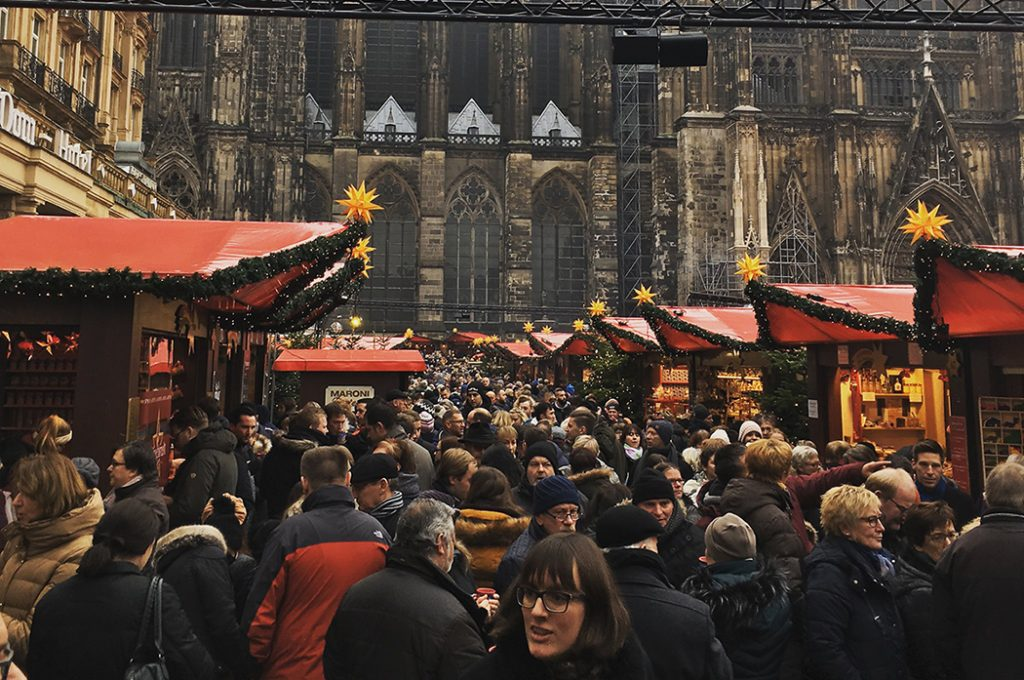 Photo of a busy Christmas market in Cologne.