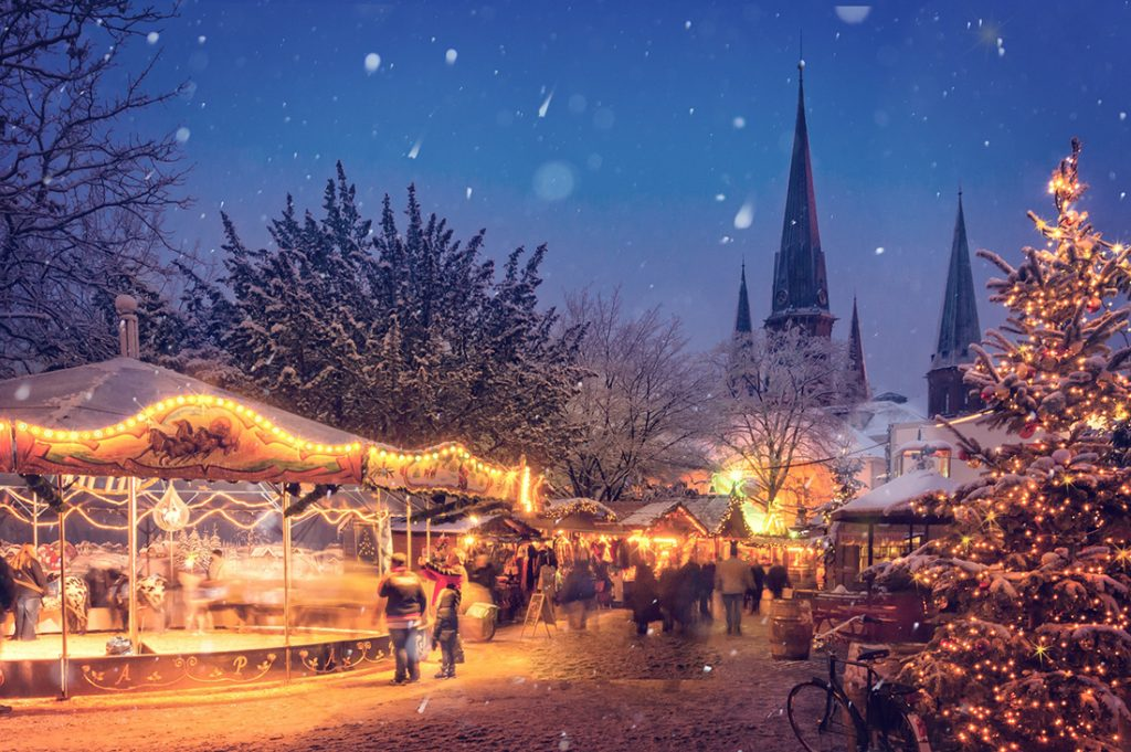 Photo of a Christmas market in Germany, as snow gently falls.