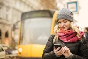 Photo of a woman about to board a bus with her mobile boarding pass.