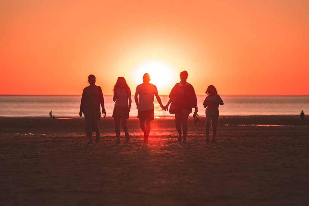 A family of five at the beach.