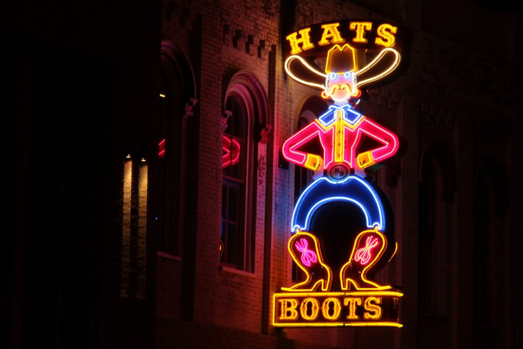 Photo of a honky-tonk sign in downtown Nashville.