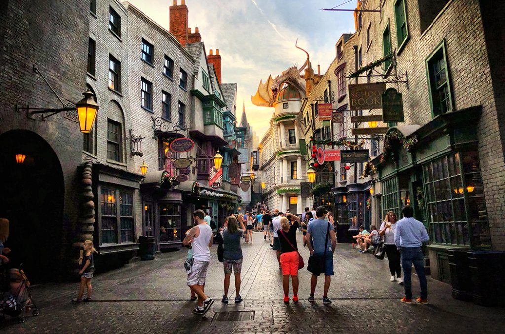 Photo of a family walking down Diagon Alley.