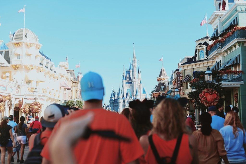 Crowds walk down the Main Street in Orlando's Disney World.