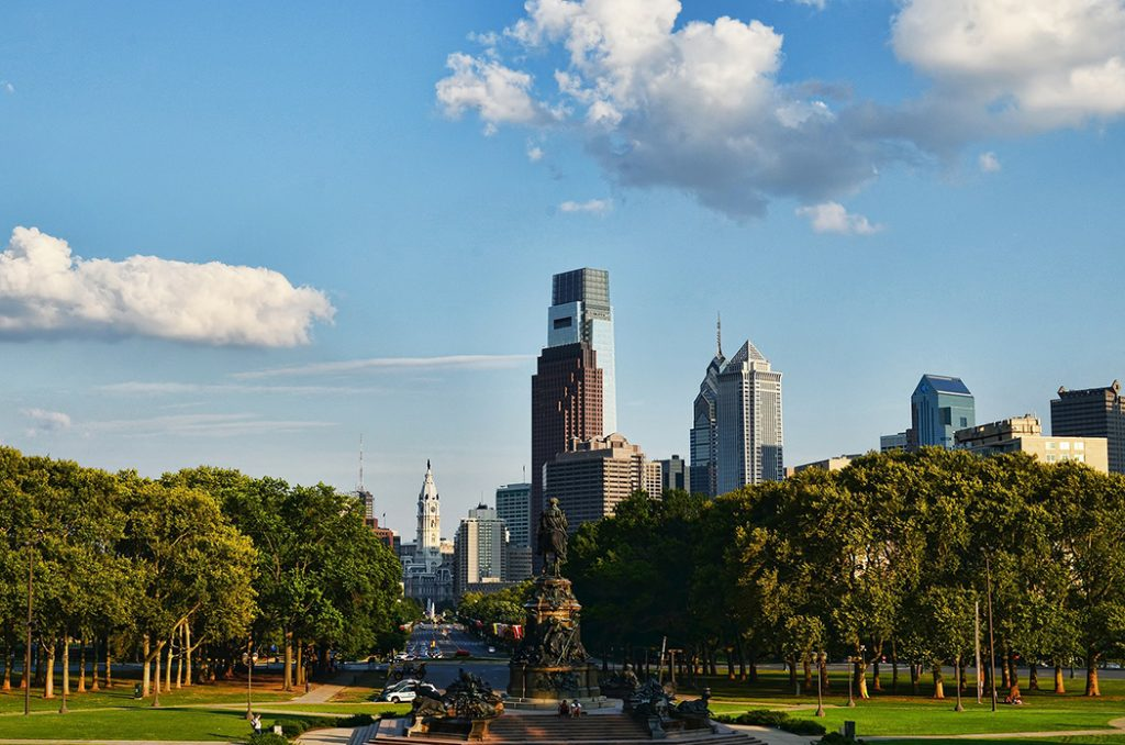 Photo of the Philadelphia skyline from a park outside of downtown.