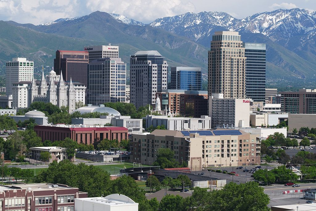 Photo of downtown Salt Lake City with snow-capped mountains in the background.