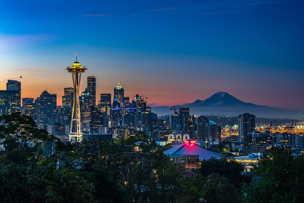 Photo of the Seattle skyline at night, with a view of the Space Needle.