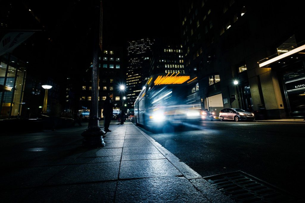 Photo of a bus traveling overnight between cities.