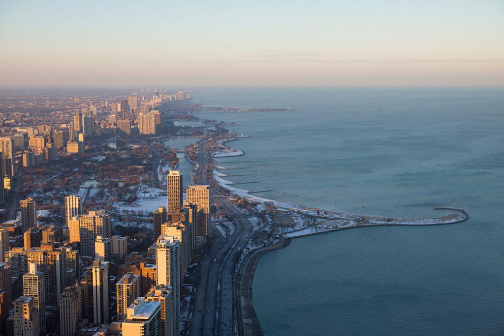 Bird's eye photo of Lake Michigan and the Chicago coastline.