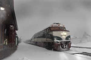 An Amtrak train pulls into the station during a snowstorm