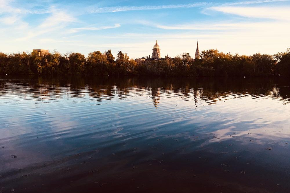 Photo of a lake at sunset in front of Notre Dame University in South Bend, Indiana.