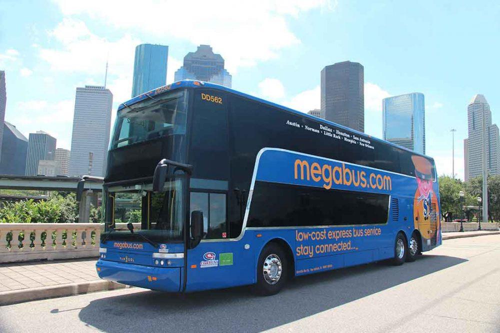 Photo of a Megabus driving through Hoston, Texas.