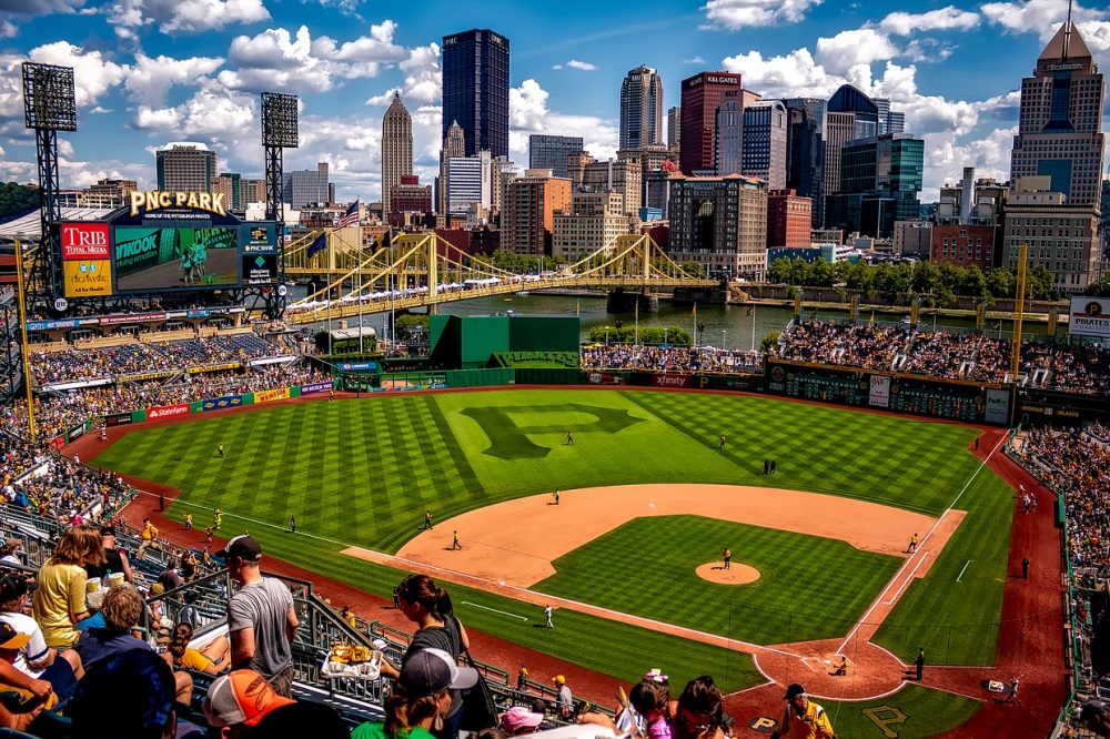 Travel to all baseball stadiums in North America.